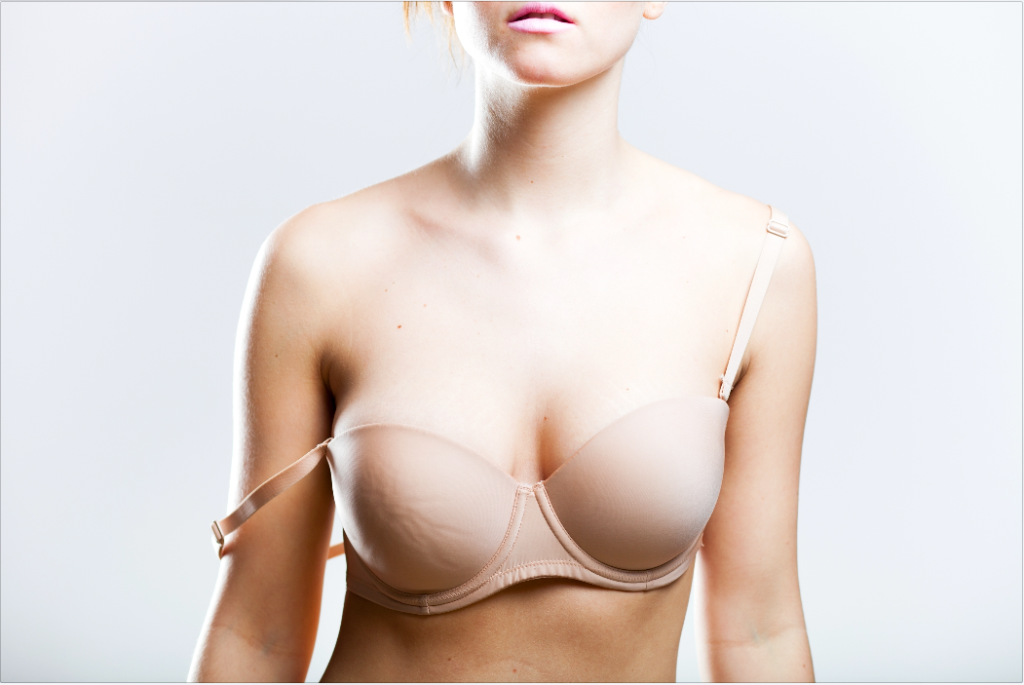 A woman wearing a bra with straps that are falling off