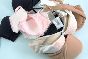 a pile of different kinds of bras